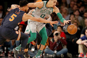 Jayson Tatum #0 of the Boston Celtics tries to keep the ball as Courtney Lee #5 of the New York Knicks defends at Madison Square Garden on February 24,2018 in New York City. NOTE TO USER: User expressly acknowledges and agrees that, by downloading and or using this Photograph, user is consenting to the terms and conditions of the Getty Images License Agreement
