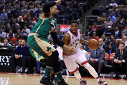 Kyle Lowry #7 of the Toronto Raptors dribbles the ball as Jared Sullinger #7 of the Boston Celtics defends during the first half of an NBA game at the Air Canada Centre on March 18, 2016 in Toronto, Ontario, Canada.  NOTE TO USER: User expressly acknowledges and agrees that, by downloading and or using this photograph, User is consenting to the terms and conditions of the Getty Images License Agreement.