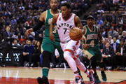 Kyle Lowry #7 of the Toronto Raptors dribbles the ball as Jared Sullinger #7 and Isaiah Thomas #4 of the Boston Celtics defend during the first half of an NBA game at the Air Canada Centre on March 18, 2016 in Toronto, Ontario, Canada.  NOTE TO USER: User expressly acknowledges and agrees that, by downloading and or using this photograph, User is consenting to the terms and conditions of the Getty Images License Agreement.