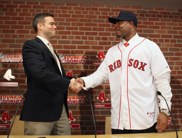 Theo Epstein (L), general manager of the Boston Red Sox, welcomes Carl Crawford to the team during a press conference to announce Crawford's signing on December 11,  2010 at the Fenway Park in Boston, Massachusetts.
