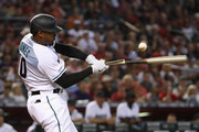Adam Jones #10 of the Arizona Diamondbacks breaks his bat as he swings during the third inning of the MLB game against the Boston Red Sox at Chase Field on April 05, 2019 in Phoenix, Arizona.