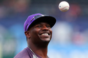 NFL Hall of Famer and former TCU running back LaDainian Tomlinson throws out the ceremonial first pitch before the Texas Rangers take on the Boston Red Sox at Globe Life Park in Arlington on May 3, 2018 in Arlington, Texas.