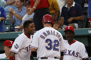 Josh Hamilton #32 is congratulated by manager Ron Washington #38 manager of the Texas Rangers and Elvis Andrus #1 for scoring on a single hit by Michael Young #10 at Rangers Ballpark in Arlington on July 23, 2012 in Arlington, Texas.