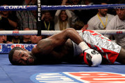 John Thompson of The USA lies on the canvas after being knocked down by Liam Smith of Great Britain leading to the end of the contest during their WBO World Super Welterweight championship bout at Manchester Arena on October 10, 2015 in Manchester, England.
