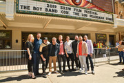 "Callie Foster, Shane Patterson, Joey Fatone, Dave Holmes, Aaron Kunkel, Matthew Charles Ducey,  Henry Darrow McComas, Lance Bass, and Nicholas Caprio attend the ""The Boy Band Con: The Lou Pearlman Story"" Premiere - 2019 SXSW Conference and Festivals at Paramount Theatre on March 13, 2019 in Austin, Texas."