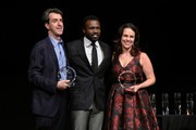 Actor Joshua Henry (C) presents an award to Composer Jason Robert Brown (L) and Georgia Stitt  (R) onstage during the Brady Center's 2018 Bear Awards honoring real life heroes helping to prevent gun violence at Gotham Hall on October 1, 2018 in New York City.
