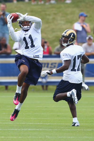 Brandon Gibson catches a pass over Donnie Avery in drills