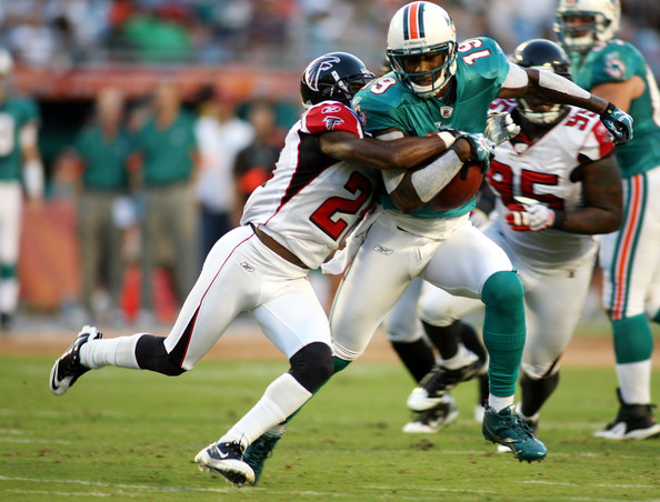 Brandon Marshall Wide reciever Brandon Marshall #16 of the Miami Dolphins runs with the ball  against cornerback Brent Grimes #20 of the Atlanta Falcons during their preseason game at Sun Life Stadium on August 27, 2010 in Miami, Florida.