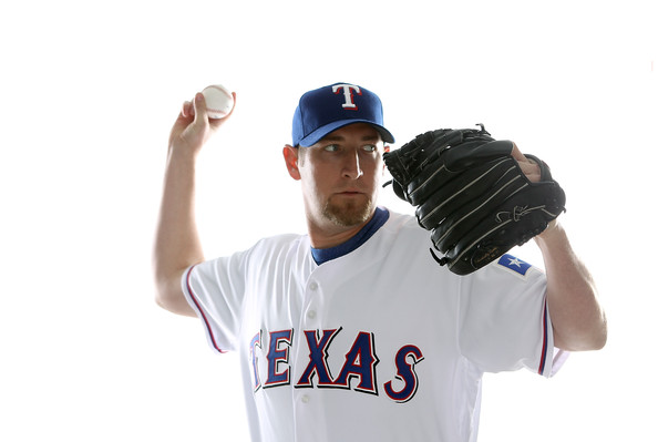 Brandon Webb Brandon Webb #33 of the Texas Rangers poses for a portrait during Spring Training Media Day on February 25, 2011 at Surprise Stadium in Surprise, Arizona.