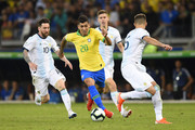 Roberto Firmino of Brazil controls the ball against Lionel Messi of Argentina during the Copa America Brazil 2019 Semi Final match between Brazil and Argentina at Mineirao Stadium on July 02, 2019 in Belo Horizonte, Brazil.