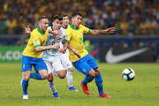 Marcos Acuña of Argentina fights for the ball with Arthur and Roberto Firmino of Brazil during the Copa America Brazil 2019 Semi Final match between Brazil and Argentina at Mineirao Stadium on July 02, 2019 in Belo Horizonte, Brazil.