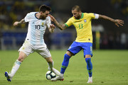 Lionel Messi of Argentina fights for the ball with Dani Alves of Brazil during the Copa America Brazil 2019 Semi Final match between Brazil and Argentina at Mineirao Stadium on July 02, 2019 in Belo Horizonte, Brazil.