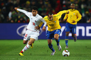 Luis Fabiano of Brazil and Gonzalo Jara of Chile battle for the ball during the 2010 FIFA World Cup South Africa Round of Sixteen match between Brazil and Chile at Ellis Park Stadium on June 28, 2010 in Johannesburg, South Africa.