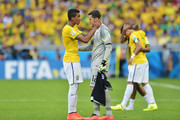 Luiz Gustavo of Brazil speaks to goalkeeper Julio Cesar before penalty kicks during the 2014 FIFA World Cup Brazil round of 16 match between Brazil and Chile at Estadio Mineirao on June 28, 2014 in Belo Horizonte, Brazil.