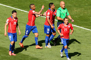 Chile players appeal for a card to referee Howard Webb after a hand ball by Hulk of Brazil (not pictured) during the 2014 FIFA World Cup Brazil round of 16 match between Brazil and Chile at Estadio Mineirao on June 28, 2014 in Belo Horizonte, Brazil.