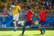 Hulk of Brazil handles the ball before scoring a goal that was disallowed during the 2014 FIFA World Cup Brazil round of 16 match between Brazil and Chile at Estadio Mineirao on June 28, 2014 in Belo Horizonte, Brazil.