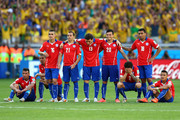 (L-R) Mauricio Isla, Francisco Silva, Felipe Gutierrez, Marcelo Diaz, Jose Rojas, Charles Aranguiz, Eugenio Mena, Gonzalo Jara and Alexis Sanchez of Chile look on after a missed penalty during the shootout of the 2014 FIFA World Cup Brazil round of 16 match between Brazil and Chile at Estadio Mineirao on June 28, 2014 in Belo Horizonte, Brazil.