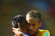 Neymar of Brazil hugs Alexis Sanchez of Chile prior to the 2014 FIFA World Cup Brazil round of 16 match between Brazil and Chile at Estadio Mineirao on June 28, 2014 in Belo Horizonte, Brazil.