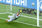 Gonzalo Jara of Chile (not pictured) shoots and hits the post to miss the decisive penalty against Julio Cesar of Brazil during the 2014 FIFA World Cup Brazil round of 16 match between Brazil and Chile at Estadio Mineirao on June 28, 2014 in Belo Horizonte, Brazil.