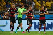 (L-R) Thomas Mueller, Manuel Neuer, Mesut Oezil and Philipp Lahm of Germany celebrate a 7-1 victory over Brazil  during the 2014 FIFA World Cup Brazil Semi Final match between Brazil and Germany at Estadio Mineirao on July 8, 2014 in Belo Horizonte, Brazil.