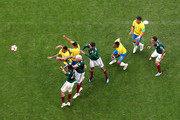 Brazil and Mexico players battle for the ball during the 2018 FIFA World Cup Russia Round of 16 match between Brazil and Mexico at Samara Arena on July 2, 2018 in Samara, Russia.