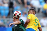 Casemiro of Brazil challenge for the ball with Andres Guardado of Mexico during the 2018 FIFA World Cup Russia Round of 16 match between Brazil and Mexico at Samara Arena on July 2, 2018 in Samara, Russia.