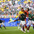 Guillermo Ochoa Jesus Gallardo Photos - Guillermo Ochoa of Mexico punches the ball clear during the 2018 FIFA World Cup Russia Round of 16 match between Brazil and Mexico at Samara Arena on July 2, 2018 in Samara, Russia. - Brazil vs. Mexico: Round of 16 - 2018 FIFA World Cup Russia