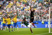 Alisson of Brazil makes a save under pressure from Carlos Vela of Mexico during the 2018 FIFA World Cup Russia Round of 16 match between Brazil and Mexico at Samara Arena on July 2, 2018 in Samara, Russia.