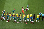 Mexico and Brazil players sahkes hands prior to the 2018 FIFA World Cup Russia Round of 16 match between Brazil and Mexico at Samara Arena on July 2, 2018 in Samara, Russia.