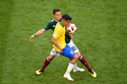 Philippe Coutinho of Brazil is challenged by Andres Guardado of Mexico  during the 2018 FIFA World Cup Russia Round of 16 match between Brazil and Mexico at Samara Arena on July 2, 2018 in Samara, Russia.