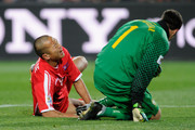 Jong Tae-Se of North Korea screams in pain after clashing with Julio Cesar of Brazil during the 2010 FIFA World Cup South Africa Group G match between Brazil and North Korea at Ellis Park Stadium on June 15, 2010 in Johannesburg, South Africa.