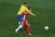 Lucio of Brazil challenges Jong Tae-Se of North Korea during the 2010 FIFA World Cup South Africa Group G match between Brazil and North Korea at Ellis Park Stadium on June 15, 2010 in Johannesburg, South Africa.