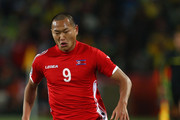 Jong Tae-Se of North Korea runs with the ball during the 2010 FIFA World Cup South Africa Group G match between Brazil and North Korea at Ellis Park Stadium on June 15, 2010 in Johannesburg, South Africa.