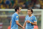 Diego Godin and Diego Forlan of Uruguay (R) look dejected at the end of the FIFA Confederations Cup Brazil 2013 Semi Final match between Brazil and Uruguay at Governador Magalhaes Pinto Estadio Mineirao on June 26, 2013 in Belo Horizonte, Brazil.