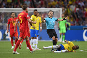 Referee Milorad Mazic gives players instructions as Fernandinho of Brazil goes down during the 2018 FIFA World Cup Russia Quarter Final match between Brazil and Belgium at Kazan Arena on July 6, 2018 in Kazan, Russia.
