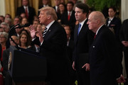 U.S. President Donald Trump (L) speaks as Supreme Court Justice Brett Kavanaugh (2nd L) and retired Justice Anthony Kennedy (R) look on during Kavanaugh's ceremonial swearing in at the East Room of the White House October 08, 2018 in Washington, DC. Kavanaugh was confirmed in the Senate 50-48 after a contentious process that included several women accusing Kavanaugh of sexual assault. Kavanaugh has denied the allegations.