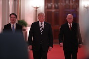(L-R) U.S. Supreme Court Justice Brett Kavanaugh, President Donald Trump and retired Justice Anthony Kennedy arrive for Kavanaugh's ceremonial swearing in in the East Room of the White House October 08, 2018 in Washington, DC. Kavanaugh was confirmed in the Senate 50-48 after a contentious process that included several women accusing Kavanaugh of sexual assault. Kavanaugh has denied the allegations..