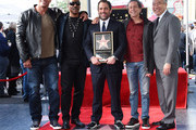 (L-R) Dwayne Johnson, Eddie Murphy, Brett Ratner, Brian Grazer and Kevin Tsujihara attend Ratner's star on the Walk of Fame ceremony in Hollywood on January 19, 2017. / AFP / CHRIS DELMAS