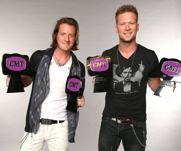 CMT Music Awards Wonderwall Portrait Studio [product,pink,outerwear,muscle,event,t-shirt,brian kelley,tyler hubbard,l-r,portrait studio,wonderwall,bridgestone arena,nashville,wonderwall portrait studio,florida georgia line,cmt music awards]