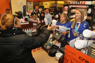 Brianna Decker U.S. Women's National Hockey Team Surprises And Serves Guests At Dunkin' Donuts