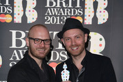 Will Champion and Jonny Buckland of Coldplay pose with the British Live Act award in the press room at the Brit Awards 2013 at the 02 Arena on February 20, 2013 in London, England.