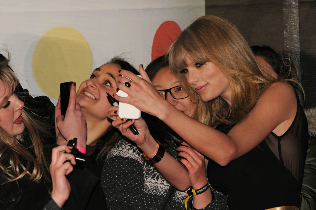 Taylor Swift takes photos with fans at the Brit Awards 2013 at the 02 Arena on February 20, 2013 in London, England.