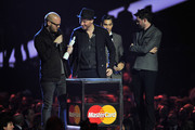 Jonny Buckland and Will Champion of Coldplay recdeive the award for British Live Act on stage during the Brit Awards 2013 at the 02 Arena on February 20, 2013 in London, England.