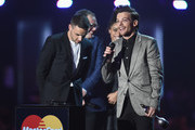 Liam Payne and Louis Tomlinson from One Direction with their British Artist Video of the Year award on stage with Alan Carr at the BRIT Awards 2016 at The O2 Arena on February 24, 2016 in London, England.
