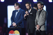 Liam Payne and Louis Tomlinson from One Direction with their British Artist Video of the Year award on stage at the BRIT Awards 2016 at The O2 Arena on February 24, 2016 in London, England.