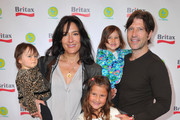 Esme Jones, actress Alicia Coppola, Greta Jones, Anthony Michael Jones and Mila Jones attend a pre-Father's Day Mini Golf Open celebrating the summer launch of the Britax Baby Carrier hosted by Britax and Baby Buggy at Castle Park on June 11, 2011 in Sherman Oaks, California.