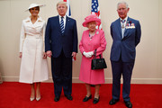 (R-L) Prince Charles, Prince of Wales, Queen Elizabeth II, President of the United States, Donald Trump and First Lady of the United States, Melania Trump prepare to meet veterans during the D-day 75 Commemorations on June 05, 2019 in Portsmouth, England. The political heads of 16 countries involved in World War II joined Her Majesty, The Queen on the UK south coast for a service to commemorate the 75th anniversary of D-Day. Overnight it was announced that all 16 had signed an historic proclamation of peace to ensure the horrors of the Second World War are never repeated. The text has been agreed by Australia, Belgium, Canada, Czech Republic, Denmark, France, Germany, Greece, Luxembourg, Netherlands, Norway, New Zealand, Poland, Slovakia, the United Kingdom and the United States of America.
