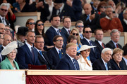 President of the United States, Donald Trump and First Lady of the United States, Melania Trump sit next to British Prime minister, Theresa May (L) President of Greece, Prokopis Pavlopoulos (2nd R) and Chancellor of Germany, Angela Merkel (R) as they attend the D-Day Commemorations on June 5, 2019 in Portsmouth, England. The political heads of 16 countries involved in World War II joined Her Majesty, The Queen on the UK south coast for a service to commemorate the 75th anniversary of D-Day. Overnight it was announced that all 16 had signed a historic proclamation of peace to ensure the horrors of the Second World War are never repeated. The text has been agreed by Australia, Belgium, Canada, Czech Republic, Denmark, France, Germany, Greece, Luxembourg, Netherlands, Norway, New Zealand, Poland, Slovakia, the United Kingdom and the United States of America.