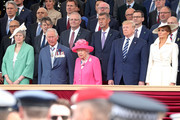 (Front row, L-R) British Prime Minister, Theresa May, Prince Charles, Prince of Wales, Queen Elizabeth II, President of the United States, Donald Trump and First Lady of the United States, Melania Trump attends the D-day 75 Commemorations on June 05, 2019 in Portsmouth, England. The political heads of 16 countries involved in World War II joined Her Majesty, The Queen is on the UK south coast for a service to commemorate the 75th anniversary of D-Day. Overnight it was announced that all 16 had signed an historic proclamation of peace to ensure the horrors of the Second World War are never repeated. The text has been agreed by Australia, Belgium, Canada, Czech Republic, Denmark, France, Germany, Greece, Luxembourg, Netherlands, Norway, New Zealand, Poland, Slovakia, the United Kingdom and the United States of America. (Photo by Chris Jackson-WPA Pool/Getty Images