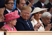 President of the United States, Donald Trump and First Lady of the United States, Melania Trump sit next to Queen Elizabeth II during the D-Day Commemorations on June 5, 2019 in Portsmouth, England. The political heads of 16 countries involved in World War II joined Her Majesty, The Queen on the UK south coast for a service to commemorate the 75th anniversary of D-Day. Overnight it was announced that all 16 had signed a historic proclamation of peace to ensure the horrors of the Second World War are never repeated. The text has been agreed by Australia, Belgium, Canada, Czech Republic, Denmark, France, Germany, Greece, Luxembourg, Netherlands, Norway, New Zealand, Poland, Slovakia, the United Kingdom and the United States of America.
